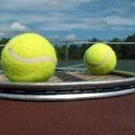 Tennis balls and racket — Stock Photo