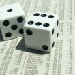 Stock Photo: White dice on stock report