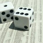 White dice on stock report — Stock Photo #1021961