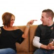 Attractive woman pointing finger into boyfriend's face — Stock Photo #1026149