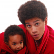 Multi-racial baby and his brother wrappe — Stock Photo