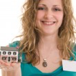 Woman holding miniature house — Stock Photo