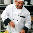 Stock Photo: Chef cutting vegetables