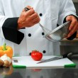 Chef with vegetables — Stock Photo