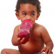 Multi-racial baby drinking -  