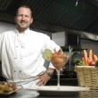 Smiling chef with vegetables and shrimp — Stock fotografie