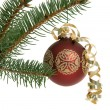 Red Christmas ornament on tree — Stock Photo