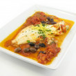 Haddock in a red sauce — Stock Photo