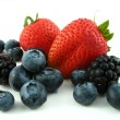 Mixed berries isolated on white — Stock Photo