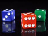 Red, green, and blue dice — Stock Photo