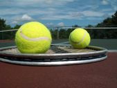 Tennis balls and racket — Stock Photo
