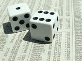 White dice on stock report — Stock Photo
