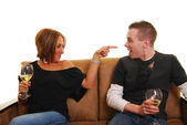 Attractive woman pointing finger into boyfriend's face — Stock Photo