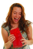 Beautiful woman opening a gift — Stock Photo