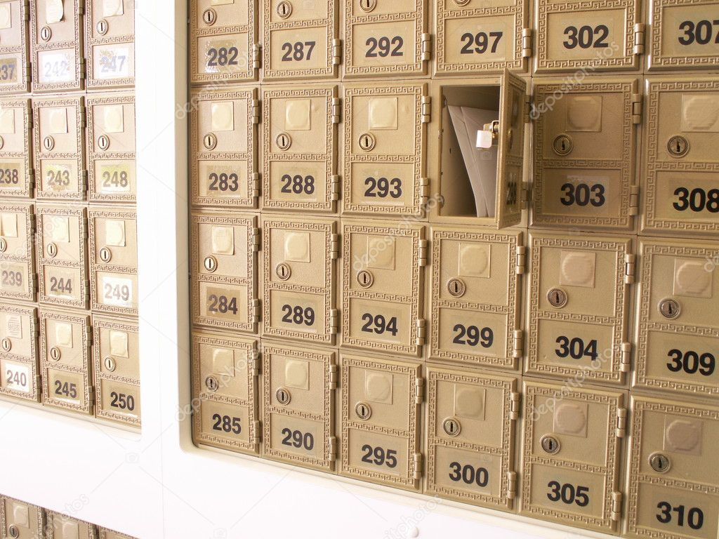 Letters in an open mailbox in a wall of mailboxes — Stock Photo #1022093