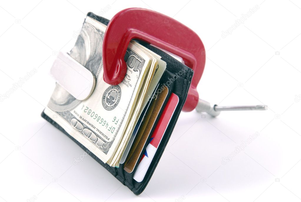 Wallet with cash and credit cards squeezed in a clamp. — Stock Photo #1023241