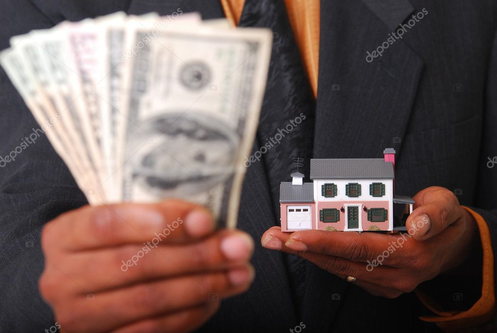 African-American male hands holding a miniature house and American currency. Shallow DOF with focus on house. — Stock Photo #1026451