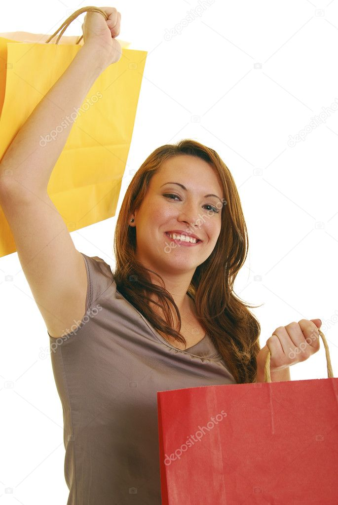 Happy, attractive Caucasian woman holding shopping bags. — Stock Photo #1028307