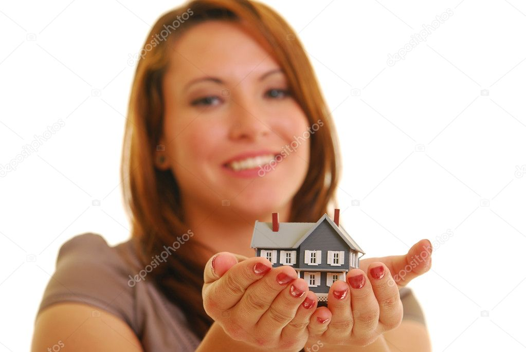 Smiling Caucasian woman holding miniature house. Shallow DOF. Focus on hands. — Stock Photo #1028431