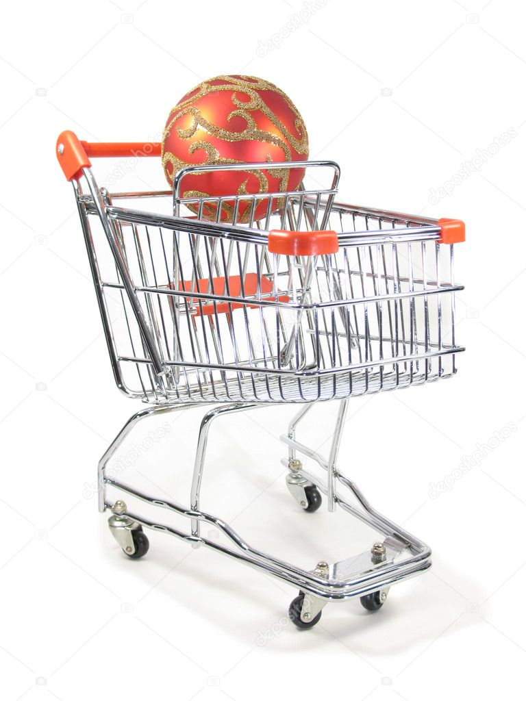 A christmas ornament in a miniature shopping cart.  Stock Photo #1028898