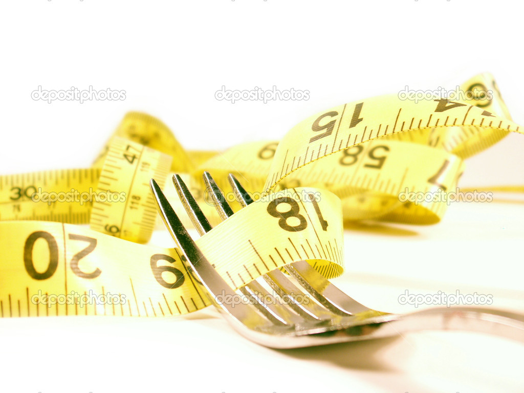 Tape measure wrapped around silver fork isolated on white — Stock Photo #1029047