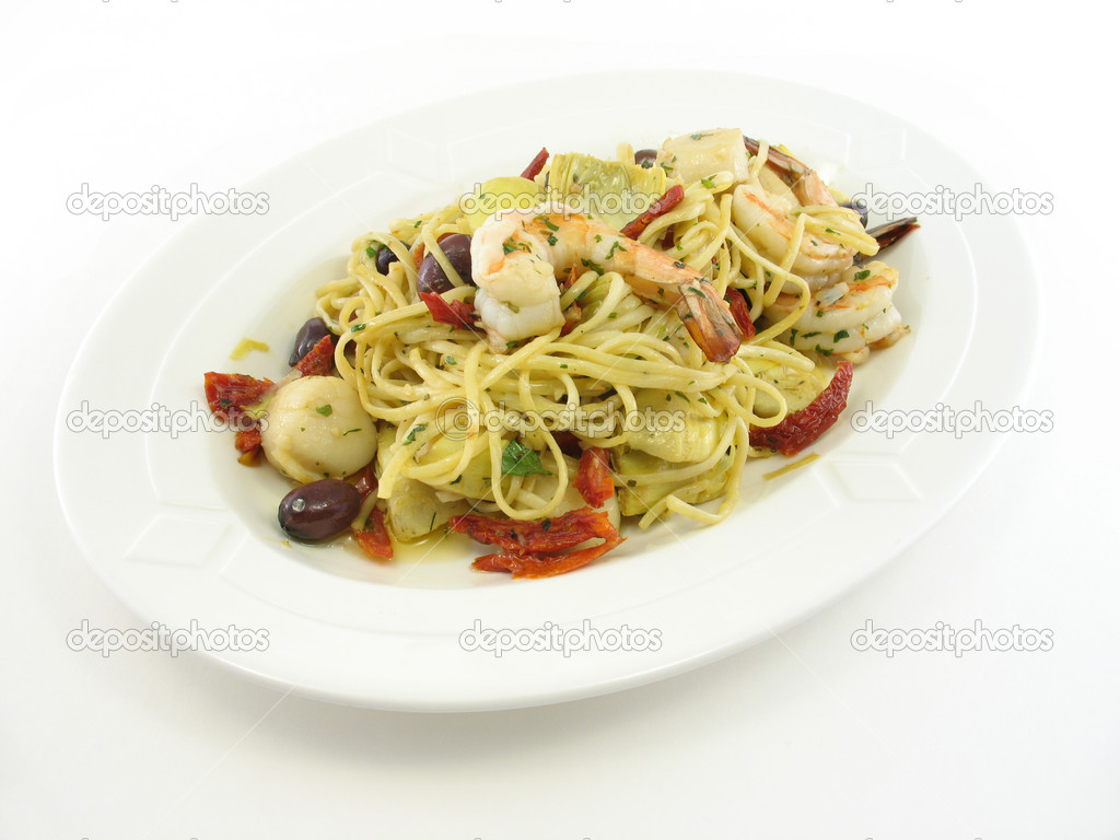 Mixed seafood on a white plate isolated on white  Stock Photo #1029232