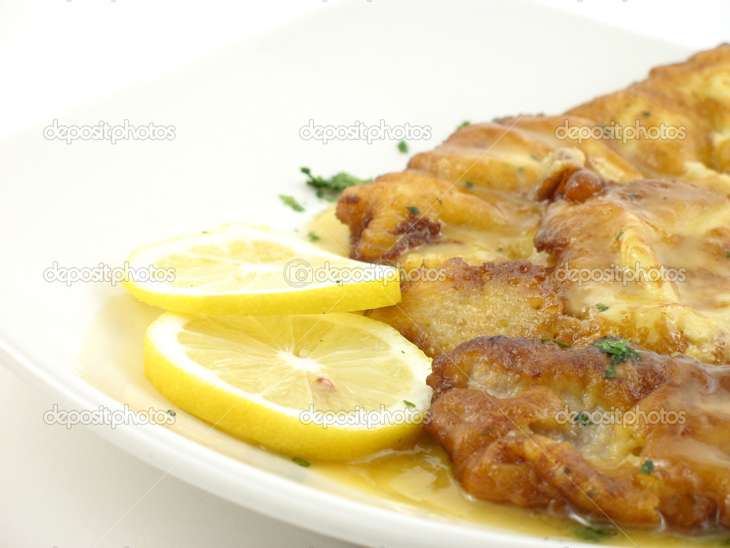 Chicken with a lemon sauce on a white plate on white background — Stock Photo #1029263