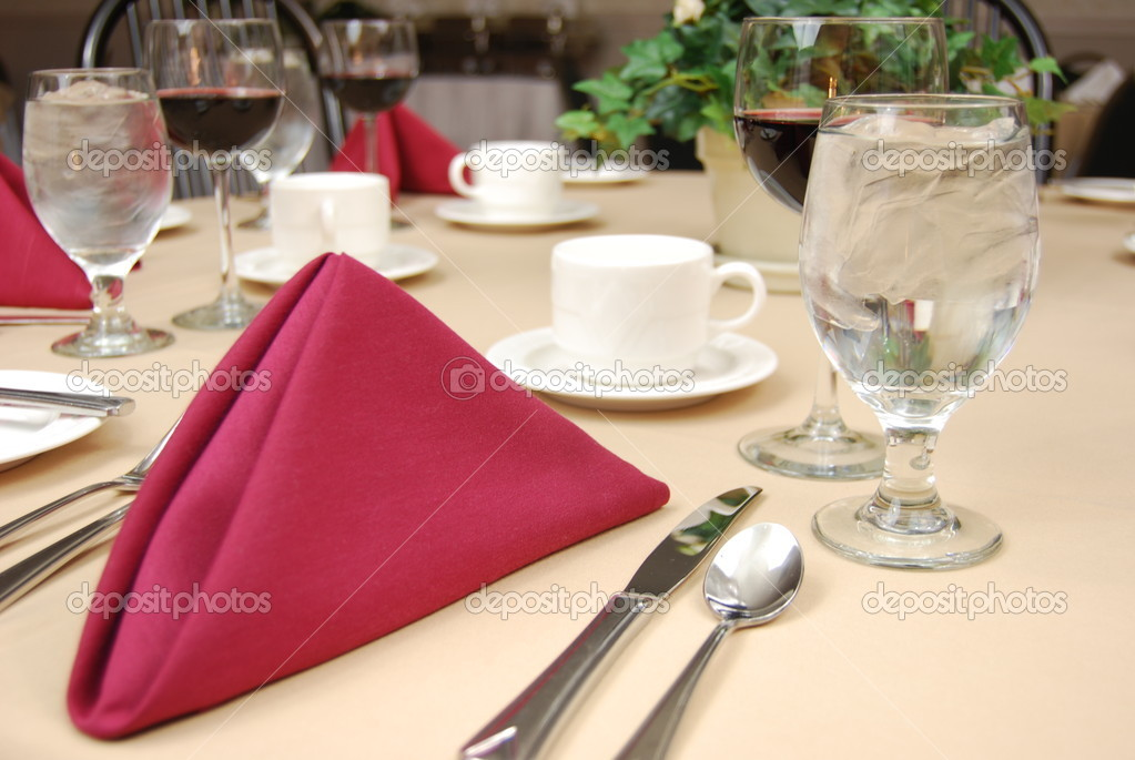 Napkin, silverware, stoneware and glassess on a restaurant table.  Stock Photo #1029522