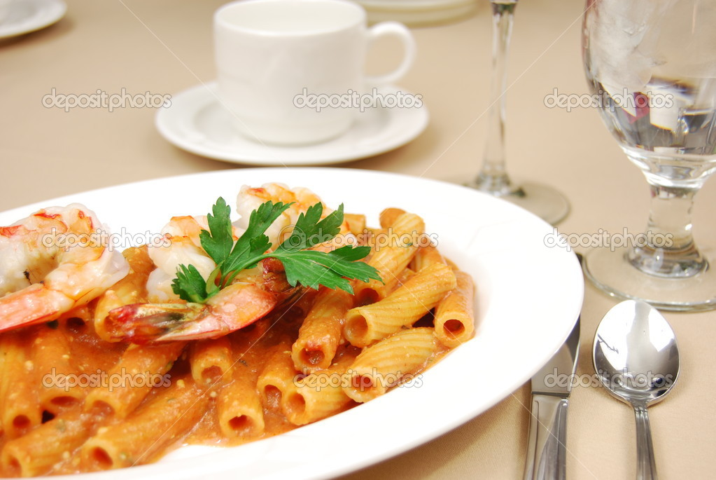 Shrimp over rigatoni in a red sauce on a restaurant table — Stock Photo #1029531