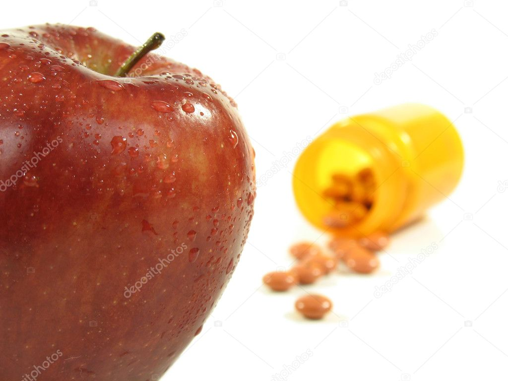 Apple and pills spilling out of bottle on white. — Stock Photo #1029933