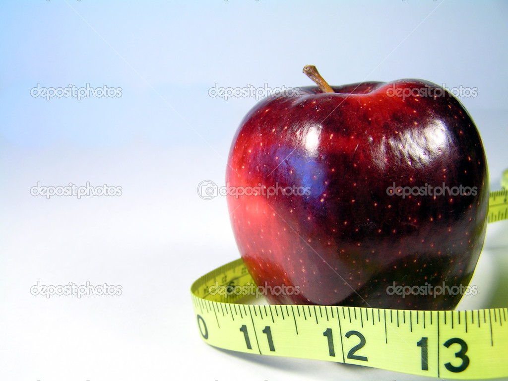 Apple on white with measuring tape signifying weight watching or weight loss  Lizenzfreies Foto #1029947