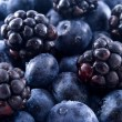 Stock Photo: Blackberries and blueberries in pile