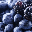 Stock Photo: Blackberries and blueberries in a pile