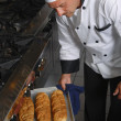 Chef with fresh bread — Stock Photo