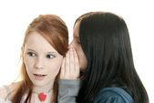 Sisters sharing secrets — Stock Photo