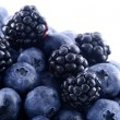 Blackberries and blueberries in a pile - Stock Photo