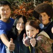 Ethnic teen thumbs up - Stok fotoraf