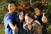 Ethnic teen thumbs up — Stock Photo