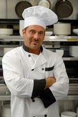 Smiling chef in uniform — Stok fotoğraf