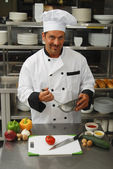 Chef with vegetables — Stockfoto