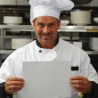 Chef with blank sign — Stock Photo