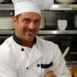 Smiling chef with spoon — Stock Photo