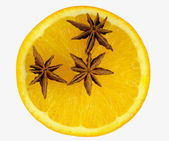 Star anise in orange, — Stock Photo