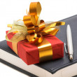 Stock Photo: Red gift and notebook with pen