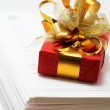 Notebook and red gift — Stock Photo