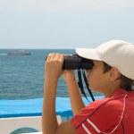 Child with binoculars — Stock Photo #1541800