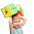 A child plays with toy blocks — Stock Photo #1647143