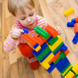 A child plays with toy blocks — Stock Photo