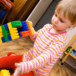 A child plays with toy blocks — Stock Photo #1647323
