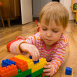 Stock Photo: A child plays with toy blocks